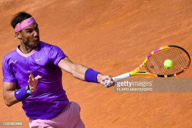Spain's Rafael Nadal returns a shot to Canada's Denis Shapovalov during their match of the Men's Italian Open at Foro Italico on May 13, 2021 in...