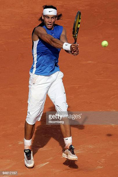 Spain's Rafael Nadal returns a shot to Switzerland's Roger Federer at the men's final of the French Open tennis tournament at Roland Garros stadium...