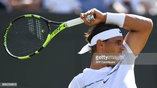 TOPSHOT Spain's Rafael Nadal returns against Australia's John Millman during their men's singles first round match on the first day of the 2017...