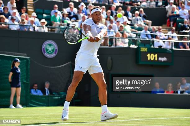 Spain's Rafael Nadal returns against Australia's John Millman during their men's singles first round match on the first day of the 2017 Wimbledon...