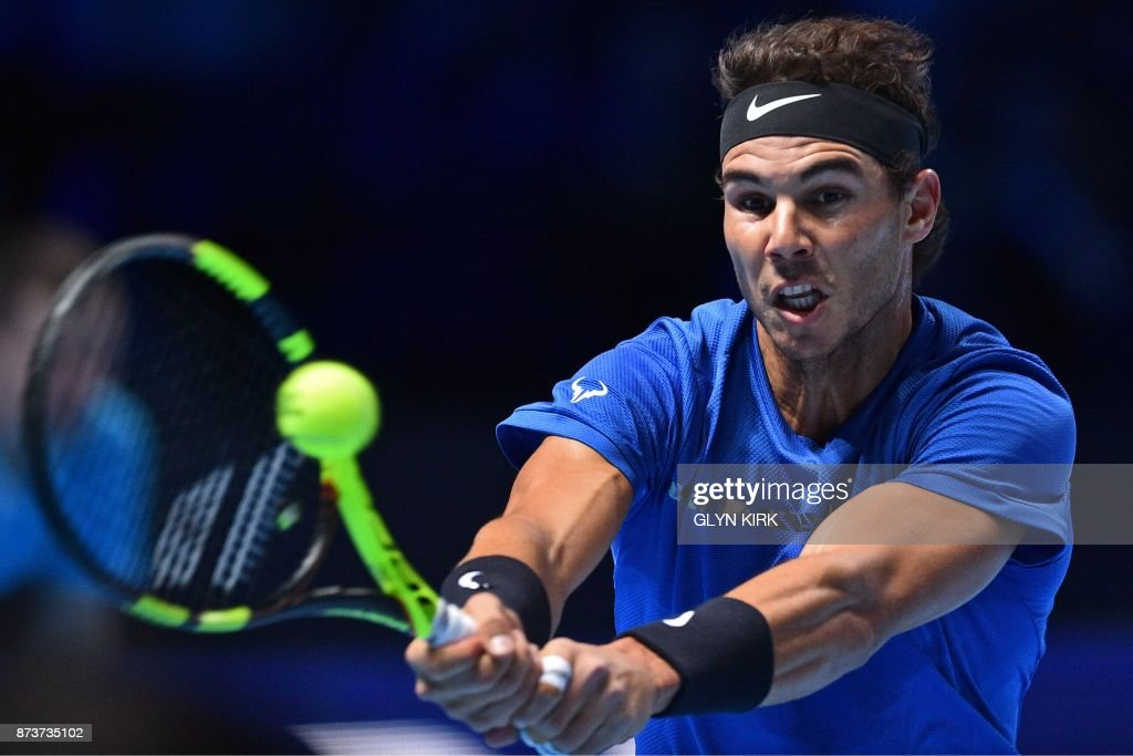 Spain's Rafael Nadal returns against Belgium's David Goffin during their singles match on day two of the ATP World Tour Finals tennis tournament at the O2 Arena in London on November 13, 2017. / AFP PHOTO / Glyn KIRK