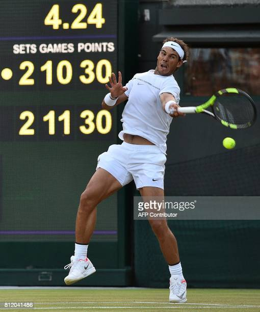 Spain's Rafael Nadal returns against Luxembourg's Gilles Muller in the fifth set tiebreak of their men's singles fourth round match on the seventh...