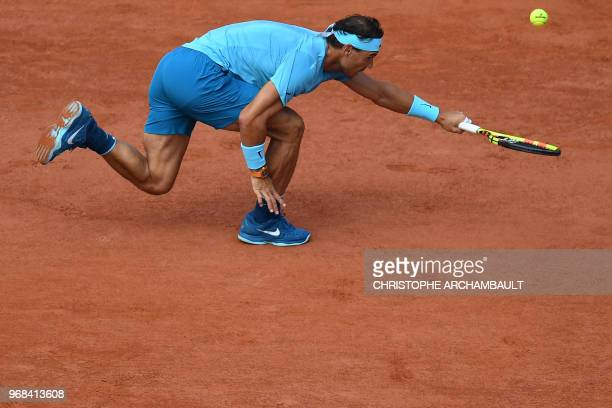 Spain's Rafael Nadal returns the ball to Argentina's Diego Schwartzman during their men's singles quarter-final match on day eleven of The Roland...