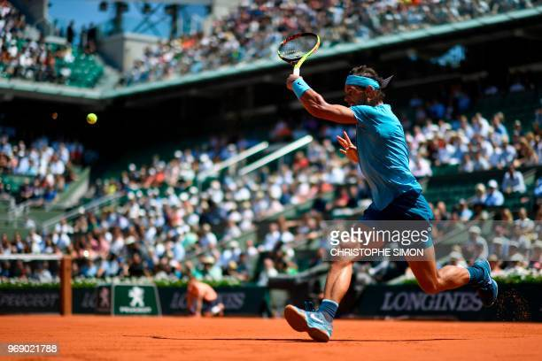 TOPSHOT Spain's Rafael Nadal returns the ball to Argentina's Diego Schwartzman during their men's singles quarterfinal match on day twelve of The...