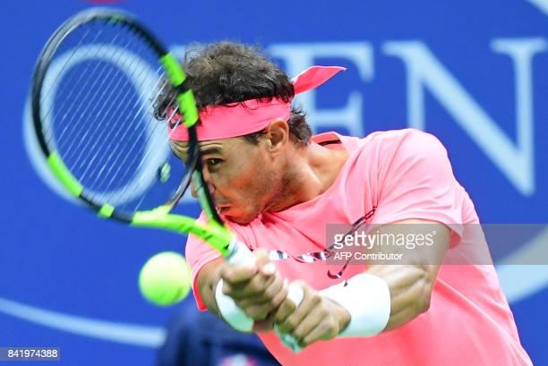 Spain's Rafael Nadal returns the ball to Argentina's Leonardo Mayer during their 2017 US Open Men's Singles match at the USTA Billie Jean King...