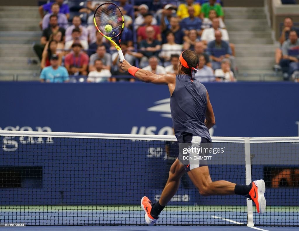Spain's Rafael Nadal returns the ball to Austria's Dominic Thiem during their Men's Singles Quarter-Finals match at the 2018 US Open at the USTA Billie Jean King National Tennis Center in New York on September 5, 2018.