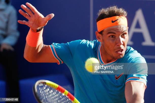 Spain's Rafael Nadal returns the ball to Austria's Dominic Thiem during the ATP Tour Barcelona Open semifinal tennis match in Barcelona on April 27...