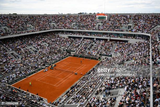Spain's Rafael Nadal returns the ball to Austria's Dominic Thiem during their men's singles final match, on day fifteen of The Roland Garros 2019...