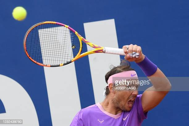 Spain's Rafael Nadal returns the ball to Belarus' Ilya Ivashka during their ATP Barcelona Open tennis tournament singles match against Belarus' Ilya...