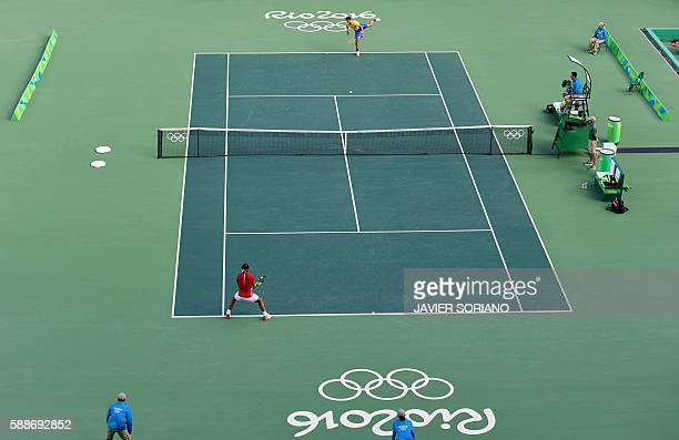 Spain's Rafael Nadal returns the ball to Brazil's Thomaz Bellucci during their men's singles quarterfinals tennis match at the Olympic Tennis Centre...