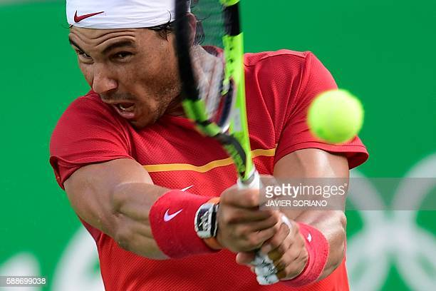 Spain's Rafael Nadal returns the ball to Brazil's Thomaz Bellucci during their men's singles quarter-final tennis match at the Olympic Tennis Centre...