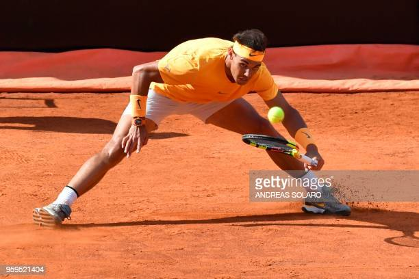 TOPSHOT Spain's Rafael Nadal returns the ball to Canada's Denis Shapovalov during Rome's ATP Tennis Open tournament at the Foro Italico on May 17...