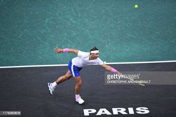 Spain's Rafael Nadal returns the ball to France's Jo-Wilfried Tsonga during their men's singles quarter-final tennis match at the ATP World Tour...