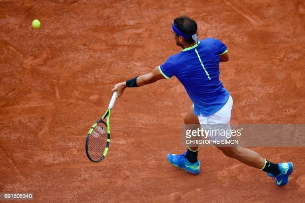 Spain's Rafael Nadal returns the ball to Georgia's Nikoloz Basilashvili during their tennis match at the Roland Garros 2017 French Open on June 2...