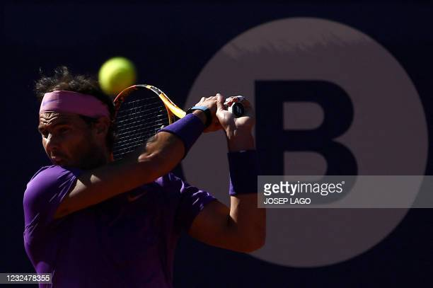 Spain's Rafael Nadal returns the ball to Great Britain's Cameron Norrie during their ATP Barcelona Open tennis tournament singles quarter-final match...