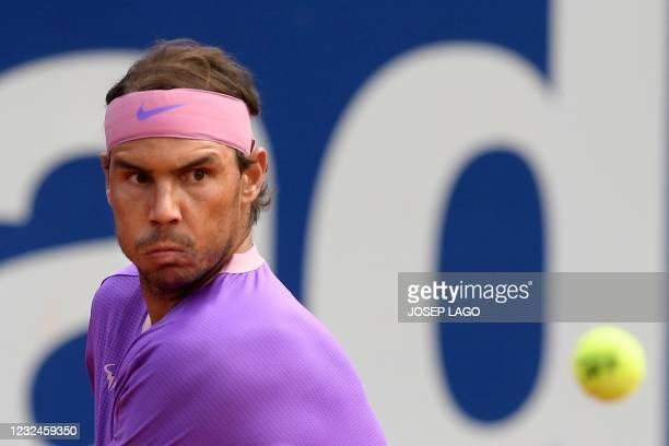 Spain's Rafael Nadal returns the ball to Japan's Kei Nishikori during their ATP Barcelona Open tennis tournament singles match at the Real Club de...