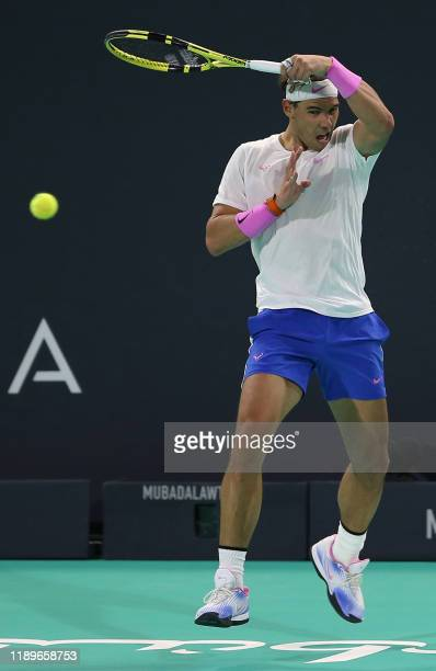 Spain's Rafael Nadal returns the ball to Russia's Karen Khachanov during a semifinal match of the Mubadala World Tennis Championship at Zayed Sports...
