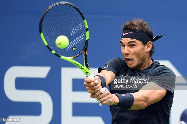 Spain's Rafael Nadal returns the ball to South Africa's Kevin Anderson during their 2017 US Open Men's Singles final match at the USTA Billie Jean...