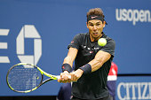 spains rafael nadal returns ball to