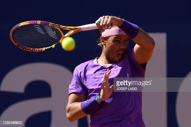 Spain's Rafael Nadal returns the ball to Spain's Pablo Carreno Busta during their ATP Barcelona Open tennis tournament singles semi-final match at...