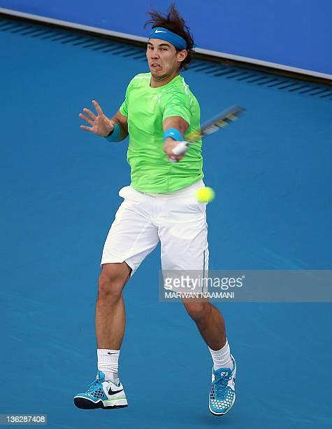 Spain's Rafael Nadal returns the ball to Switzerland's Roger Federer during their Mubadala World Tennis Championship match in the Emirati capital Abu...