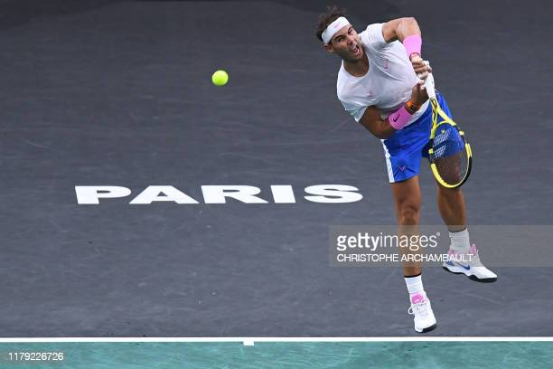 Spain's Rafael Nadal returns the ball to Switzerland's Stan Wawrinka during their men's singles tennis match on day four of the ATP World Tour...