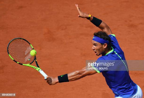 Spain's Rafael Nadal returns the ball to Switzerland's Stanislas Wawrinka during the men's final tennis match at the Roland Garros 2017 French Open...