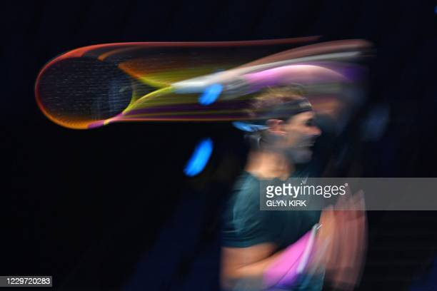Spain's Rafael Nadal returns to Russia's Daniil Medvedev during their men's singles semi-final match on day seven of the ATP World Tour Finals tennis...