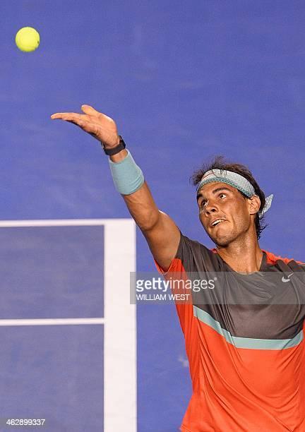 Spain's Rafael Nadal serves against Australia's Thanasi Kokkinakis during their men's singles match on day four of the 2014 Australian Open tennis...