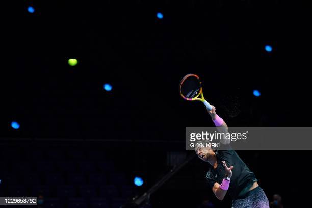 Spain's Rafael Nadal serves against Austria's Dominic Thiem in their men's singles round-robin match on day three of the ATP World Tour Finals tennis...
