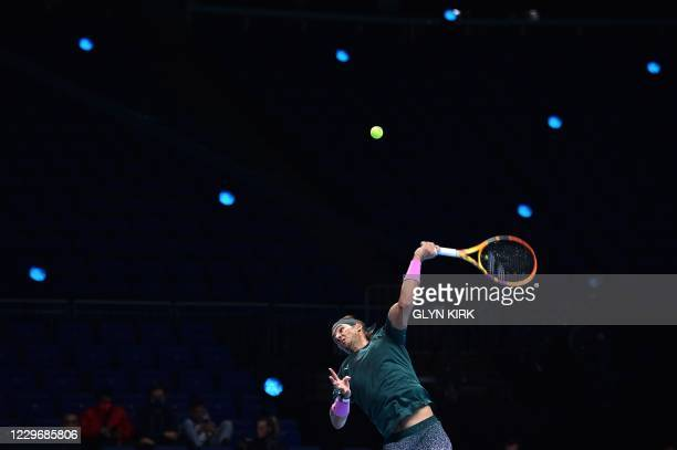 Spain's Rafael Nadal serves against Greece's Stefanos Tsitsipas in their men's singles round-robin match on day five of the ATP World Tour Finals...