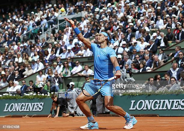 Spain's Rafael Nadal serves against Spain's Nicolas Almagro during the men's second round of the Roland Garros 2015 French Tennis Open in Paris on...