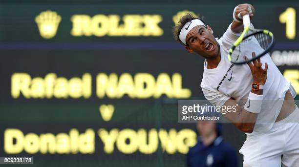 Spain's Rafael Nadal serves against US player Donald Young during their men's singles second round match on the third day of the 2017 Wimbledon...