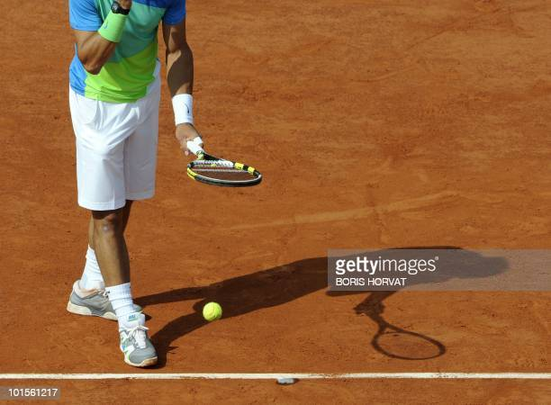 Spain's Rafael Nadal serves during his men's quarter-final against compatriot Nicolas Almagro in the French Open tennis championship at the Roland...
