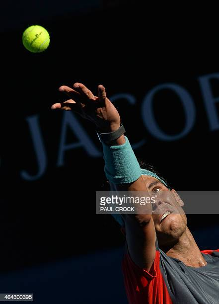 Spain's Rafael Nadal serves during his men's singles match against Bulgaria's Grigor Dimitrov on day ten of the 2014 Australian Open tennis...