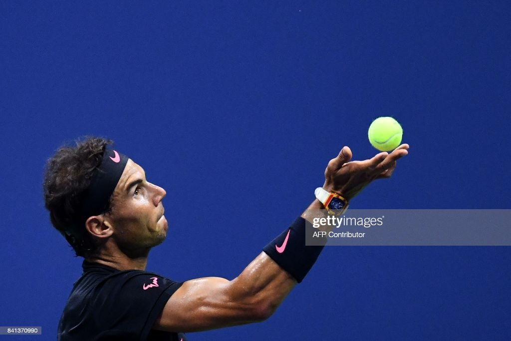 TOPSHOT - Spain's Rafael Nadal serves the ball against Japan's Taro Daniel during their 2017 US Open Men's Singles match at the USTA Billie Jean King National Tennis Center in New York on August 31, 2017. PHOTO / Jewel SAMAD