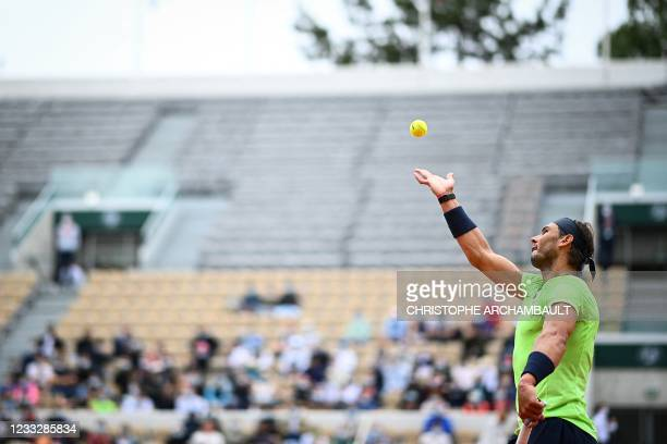 Spain's Rafael Nadal serves the ball to Britain's Cameron Norrie during their men's singles third round tennis match on Day 7 of The Roland Garros...