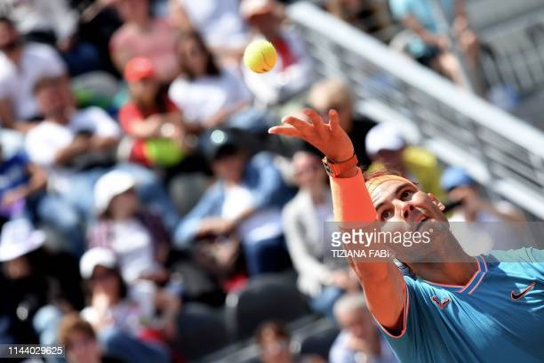 Spain's Rafael Nadal serves the ball to France's Jeremy Chardy during their ATP Masters tournament tennis match at the Foro Italico in Rome on May 16...