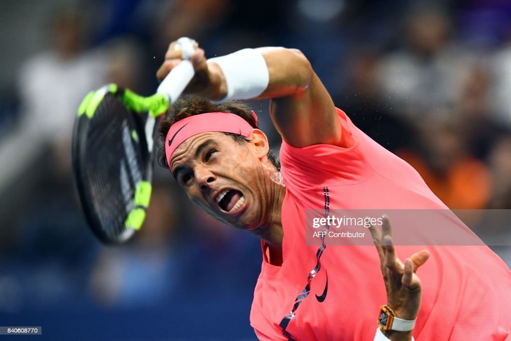 TOPSHOT - Spain's Rafael Nadal serves the ball to Serbia's Dusan Lajovic during their 2017 US Open Men's Singles match at the USTA Billie Jean King National Tennis Center in New York on August 29, 2017. / AFP PHOTO / Jewel SAMAD