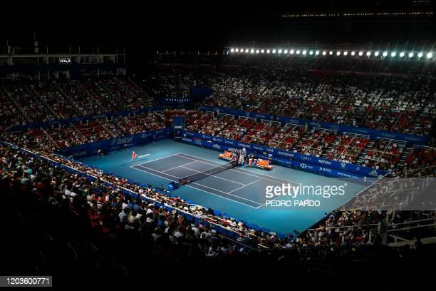 Spain's Rafael Nadal serves the ball to Serbia's Miomir Kecmanovic during their Mexico ATP Open 500 men's singles tennis match in Acapulco Guerrero...
