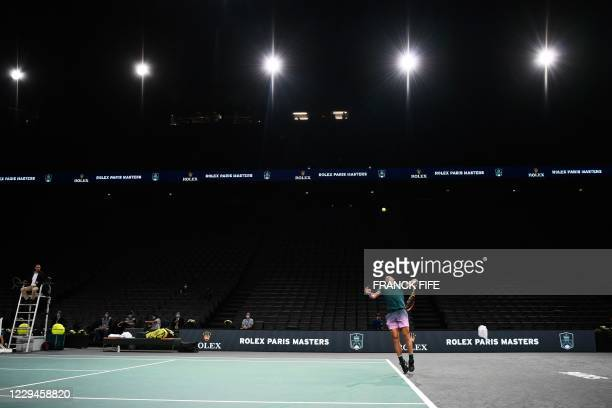 Spain's Rafael Nadal serves the ball to Spain's Feliciano Lopez during their men's singles second round tennis match on day 3 at the ATP World Tour...