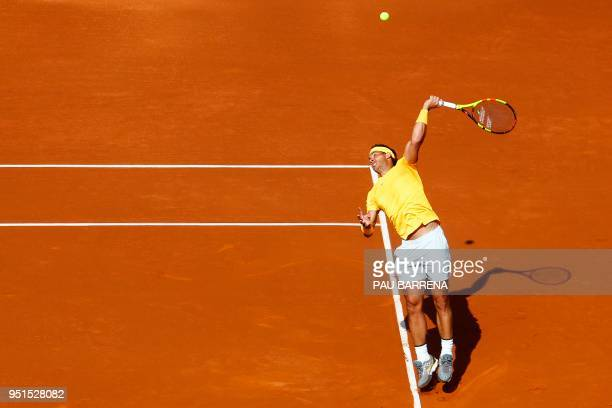 Spain's Rafael Nadal serves the ball to Spain's Guillermo Garcia-Lopez during their Barcelona Open ATP tournament tennis match in Barcelona on April...
