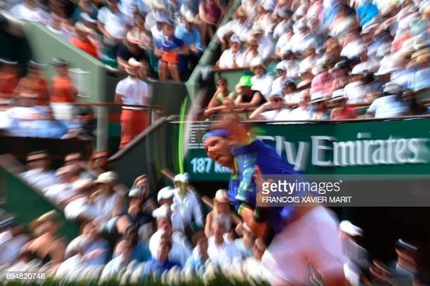 Spain's Rafael Nadal serves the ball to Switzerland's Stanislas Wawrinka during the men's final tennis match at the Roland Garros 2017 French Open on...