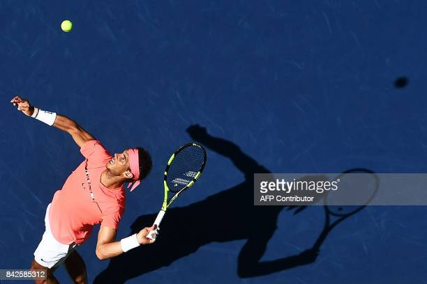 TOPSHOT Spain's Rafael Nadal serves the ball to Ukraine's Alexandr Dolgopolov during their 2017 US Open Men's Singles Round 4 match at the USTA...