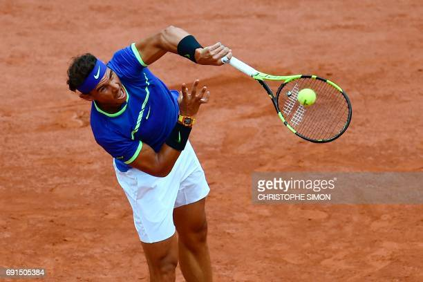 Spain's Rafael Nadal serves to Georgia's Nikoloz Basilashvili during their tennis match at the Roland Garros 2017 French Open on June 2 2017 in Paris...