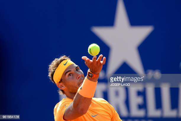Spain's Rafael Nadal serves to Slovakia's Martin Klizan during their Barcelona Open ATP tournament quarter-final tennis match in Barcelona on April...