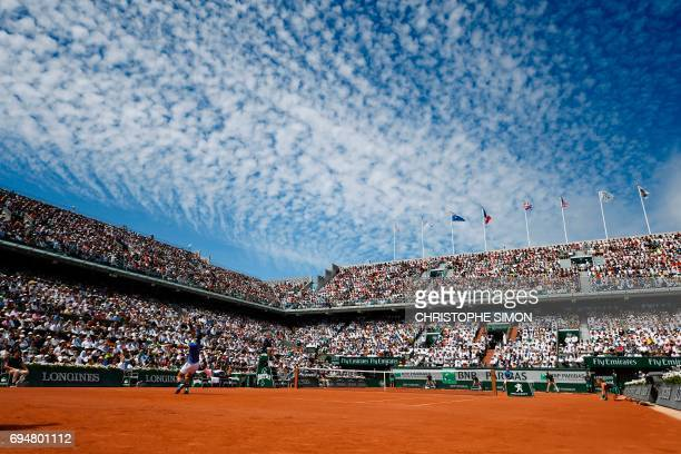 Spain's Rafael Nadal serves to Switzerland's Stanislas Wawrinka during their men final tennis match at the Roland Garros 2017 French Open on June 11,...