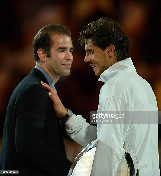 Spain's Rafael Nadal shares a light moment with former champion Pete Sampras of the US during a presentation ceremony after defeat in his mens...