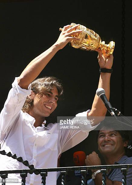 Spain's Rafael Nadal shows his trophy after he defeafed Swiss Roger Federer at Wimbledon at the Manacor's town hall, Mallorca, Balearics Islands on...