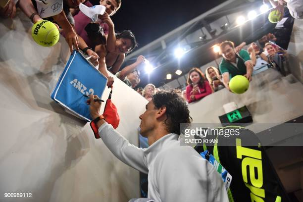 Spain's Rafael Nadal signs autographs after beating Bosnia's Damir Dzumhur in their men's singles third round match on day five of the Australian...